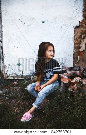 Beautiful Little Girl In Ragged Jeans.fashion Child