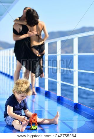 Summer Vacation Of Happy Family. Love And Trust As Family Values. Mother And Father With Son In Sea