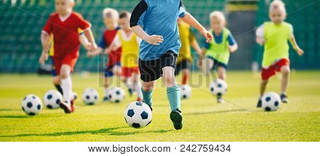 Football Soccer Training For Kids. Children Football Training Session. Kids Running And Kicking Socc