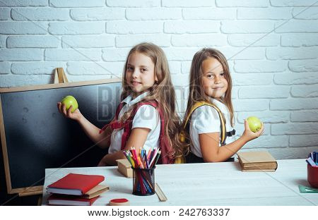 Little Girls Eat Apple At Lunch Break. Happy School Kids At Lesson In September 1. Friendship Of Sma