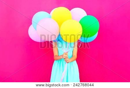 Cool Girl Is Hides Her Head An Air Colorful Balloons Having Fun Over Pink Background