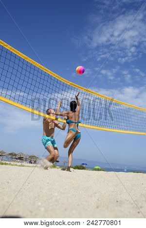 Woman And Man Fit, Strong, Healthy, Doing Sport On Beach. Beach Volleyball Concept. Couple Have Fun
