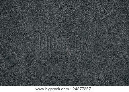 Black Fine Textured Old Cement Plaster. Dark Dappled Wall Background