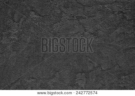 Black Rough Concrete Wall. Fine Textured Surface With Small Cracks. Dark Background