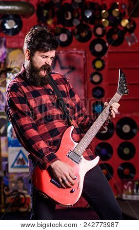 Rock Star Concept. Musician With Beard Play Electric Guitar. Man With Enthusiastic Face Holds Guitar