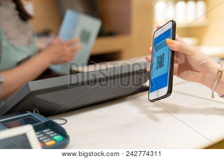 Shanghai, China - May, 2018 : Qr Code Payment , Online Shopping , Cashless Technology Concept. Women