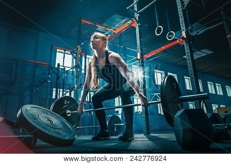 Fit Young Woman Lifting Barbells Working Out At A Gym. Sport, Fitness, Weightlifting, Bodybuilding,