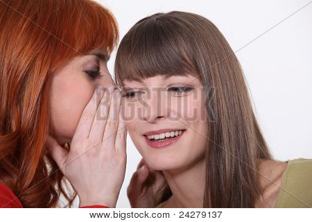 Two girls gossiping