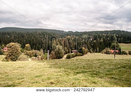 Autumn Mountain Countryside With Meadow, Few Houses, Trees And Hills Covered By Forest Near Vysni Mo
