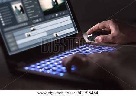 Video Editing With Laptop. Professional Editor Adding Special Effects Or Color Grading Footage For C