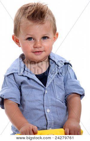 Closeup of a little boy with gelled hair using a walker