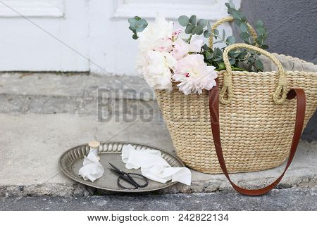 Styled Stock Photo. Feminine Wedding Still Life Composition With Straw French Basket Bag With Pink P