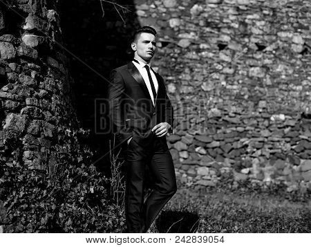 Elegant Man In Suit. Man Half Face Young Handsome Elegant Model In Suit With Skinny Necktie Poses Wi