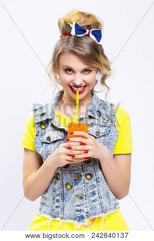 Happy Life Ideas And Concepts. Upbeat And Happy Caucasian Blond Girl With Orange Juice And Straw. We
