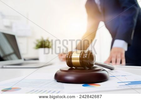 Wooden Gavel On Table. Attorney Working In Office