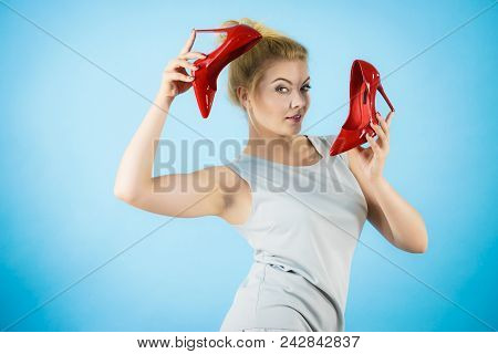 Teenage Woman Fashion Stylist Presenting Her Elegant Shoes. Beautiful Red Sensual High Heels. Outfit