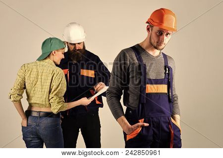 Recruitment Concept. Brigadier Hiring Workers, Sign Contract. Worker In Overalls Looks Forward. Brig