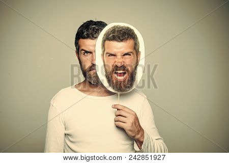 Fun Faces. Guy Or Bearded Man On Grey Background. Hipster With Serious And Angry Face Hold Portrait