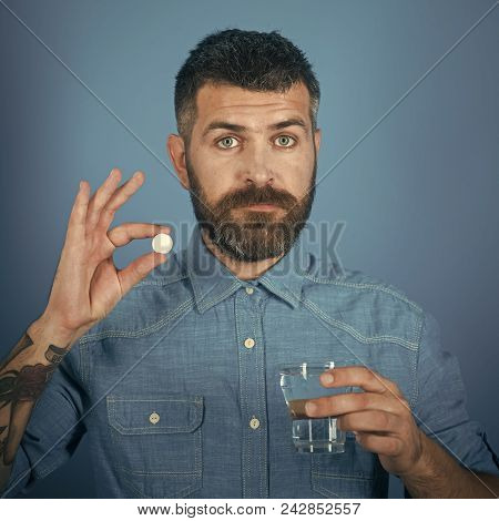 Man Looking At Camera. Handsome Man Face. Man With Beard Hold Water Glass On Blue Background, Headac