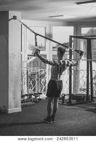 Mens Heals Body Care. Man With Nude Torso, And Muscular Back In Gym Enjoy Training, Trx. Man With To