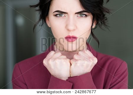 Emotion Face. Angry Mad Cross Woman Clenching Fists. Fury And Rage Concept. Young Beautiful Brunette