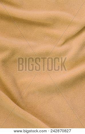 The Blanket Of Furry Orange Fleece Fabric. A Background Of Light Orange Soft Plush Fleece Material W