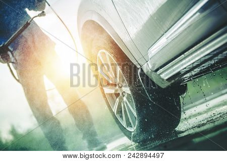 Caucasian Men Washing Dirty Car In The Self Car Wash.