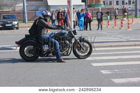 St. Petersburg, Russia - May 19, 2018: Motorbiker On Motorcycle On City Street Crosswalk. Moto Rider