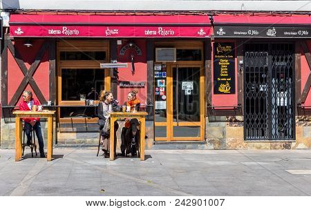 Leon, Spain - April 16, 2018: People Having A Drink At A Cafe In Leon, Spain