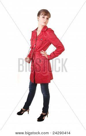 Teenager In Red Coat.