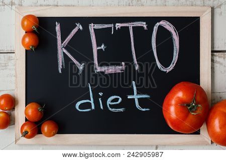 Keto Diet Concept. Ketogenic Nutrition. Blackboard With Handwritten Text