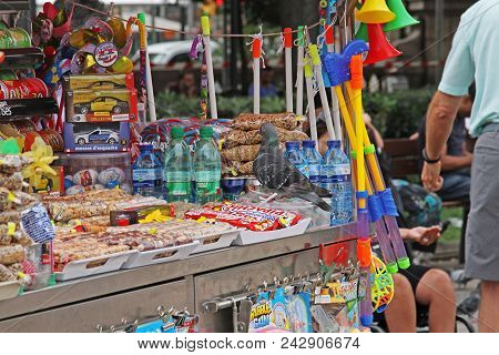 Barcelona, Spain - September 16, 2014: Pigeon Sitting On The Counter Of A Street Kiosk In Barcelona
