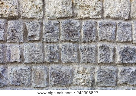 Seamless Texture Of An Old Stone Wall. Stone Stones From A Sandstone, As A Background From A Stone W