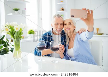 Portrait Of Lovely Attractive Stylish Cheerful Couple Drinking Alcohol Red Wine, Shooting Selfie On