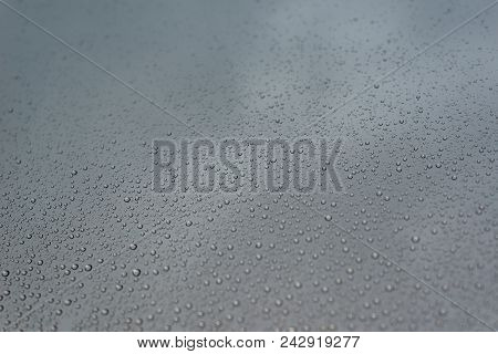 Photo Of Rain Drops On The Window Glass, With Cloudy Sky As Background