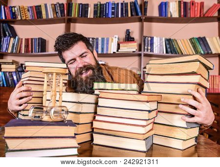 Librarian Concept. Man On Happy Face Between Piles Of Books, While Studying In Library, Bookshelves