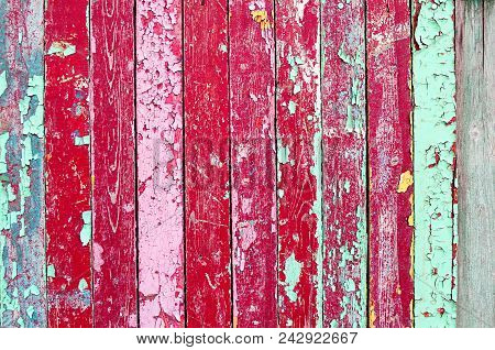 Texture Background With Weathered Painted Multicolor Wooden Planks And Peeling Paint On Them. Closeu