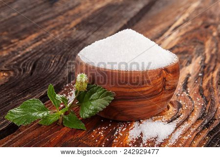 Crystal Sugar In Bowl With Aztec Sweet Herb On Wooden Table.