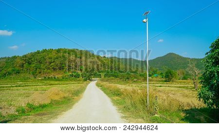 Solar Panel Is Located On A Rural Road, Solar Street Poles In Rural Areas., Beautiful Natural Landsc