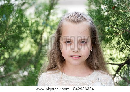 Girl With Long Hair On Calm Face, Nature Background. Girl With Tender Braids Hairstyle. Child Girl W