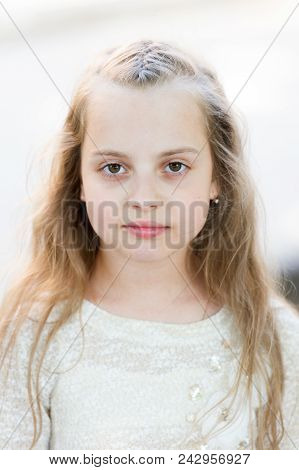 Girl With Long Hair On Calm Face, Light Background. Kid Girl Long Hair Looks Cute And Tender, Close