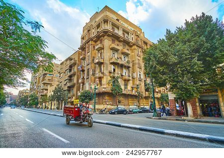 Cairo, Egypt - December 24, 2017:  The Empty Road Along The Qasr Al Nil Street Of Downtown With Tall