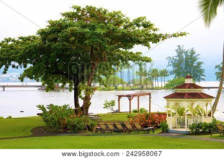 May 17, 2018 In Hilo, Hi:  Manicured Landscaping Surrounding A Gazebo Overlooking The Pacific Ocean