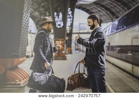 Two Happy Multi-ethnic Bearded Businessmans Together Wearing Casual Clothes And Holding Travel Bags