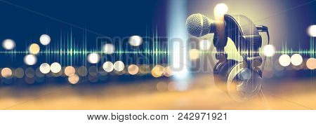 Microphone And Headphones.live Music And Blurred Stage Lights.music Background