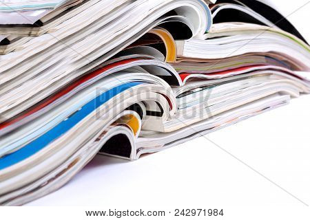 Close Up Image Of Magazines Stack Background. News And Media Publications.magazines Heap Detail
