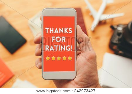 Thanks For Rating Message On Smartphone Screen In Male Hand. Customer Service Survey Feedback Concep