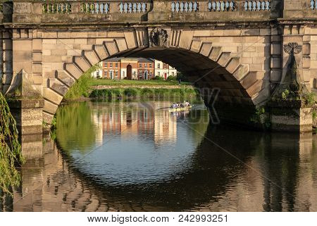 View Of River Severn And English Bridge In Shrewsbury Shropshire With Eight Rowing Boat In Backgroun