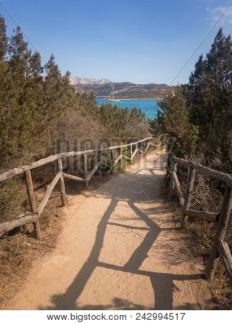 Footpath With Wooden Railing To Spiaggia Di Punta Est At Capo Coda Cavallo On The Italian Island Of