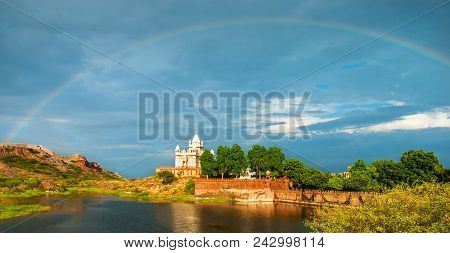 Amazing View On Jaswanth Thada Mausoleum After The Rain With A Rainbow In The Sky. Location: Jodhpur